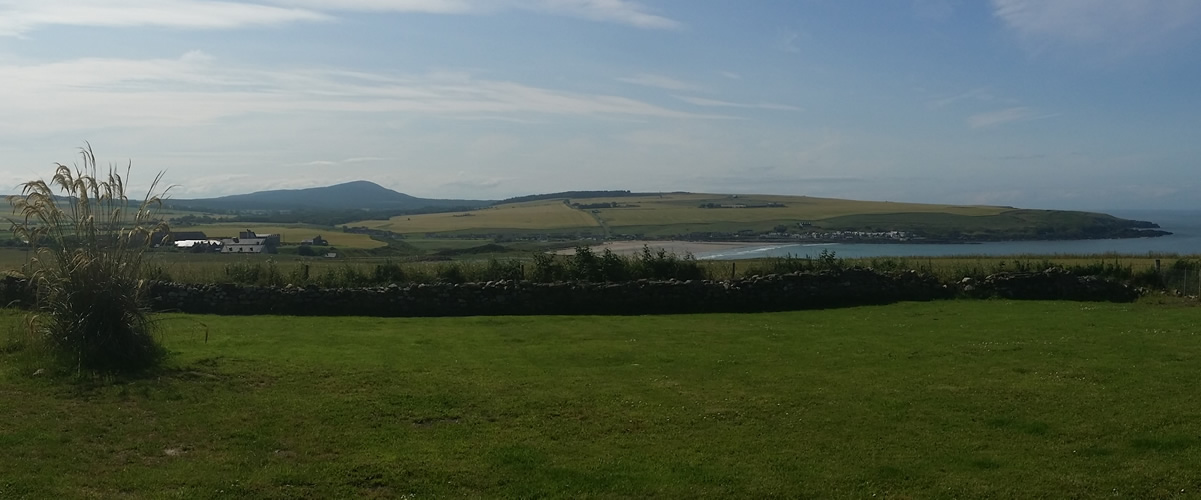 View of picturesque Sandend Bay from the rear of the Redhythe holiday cottage